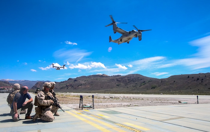 Marines with Company F, 2nd Battalion, 7th Marine Regiment, prepare to escort civilian personnel to board MV-22B Ospreys during a tactical non-combatant evacuation training mission at the Mountain Warfare Training Center in Bridgeport, Calif., Aug. 13, 2014. The Marines of 2nd Bn., 7th Marines, conducted the evacuation drill as part of Large Scale Exercise 2014. LSE-14 is a bilateral training exercise being conducted by 1st Marine Expeditionary Brigade to build U.S. and Canadian forces' joint capabilities through live, simulated, and constructive military training activities from Aug. 8-14 aboard Marine Corps Air Ground Combat Center in Twentynine Palms, Calif.
