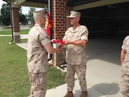 CWO4 Matthew Studer, Executive Officer of Alpha Company, Marine Corps Detachment Fort Lee, presents Sgt Justin Brown a Certificate of Commendation.  Sgt Brown was selected as the Instructor of the Quarter for Alpha Company.  (Photo provided by CWO4 Allen Ostermann, Marine Corps Detachment Public Affairs Officer/Released)