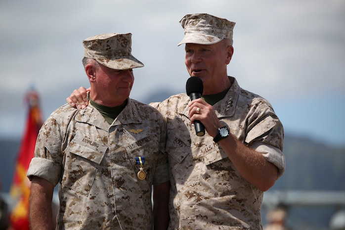 140815-M-LV138-689 MARINE CORPS BASE HAWAII – Gen. James F. Amos, commandant of the Marine Corps (right) speaks about Lt. Gen. Terry Robling, former commander of U.S. Marine Corps Forces, Pacific, during Robling's retirement ceremony Aug. 15, aboard Marine Corps Base Hawaii. Robling has served 38 years in the Marine Corps. (U.S. Marine Corps photo by Sgt. Sarah Dietz)
