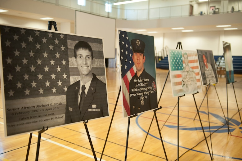 Photos of Team Buckley members lost to motorcycle, drunk driving and other accidents are displayed during the Team Buckley Safety Day Aug. 12, 2014, at the base fitness center on Buckley Air Force Base, Colo. Safety day consisted of presentations and stories designed to raise awareness of the dangers of making poor decisions on the road. (U.S. Air Force photo by Airman 1st Class Samantha Saulsbury/Released)