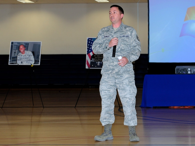 Staff Sgt. James Crawley, 460th Space Communications Squadron, recounts his motorcycle accident for Team Buckley members during the Team Buckley Safety Day Aug. 12, 2014, at the base fitness center on Buckley Air Force Base, Colo. Safety day consisted of presentations and stories designed to raise awareness of the dangers of making poor decisions on the road. (U.S. Air Force photo by Airman 1st Class Samantha Saulsbury/Released)