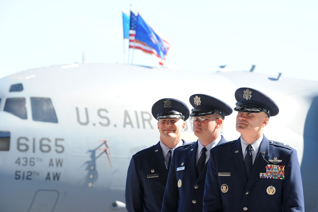 Senior officers wait before a change of command ceremony begins on Aug. 15, 2014, at Dover Air Force Base, Del. In the background is a C-17A Globemaster III 'Spirit of the Constitution' of the 436th Airlift Wing. From front to back are: Lt. Gen. Carlton D. Everhart II, 18th Air Force commander, Col. Richard G. Moore Jr. 436th AW outgoing commander and Col. Michael W. Grismer Jr., incoming 436th AW commander. (U.S. Air Force photo/Greg L. Davis)