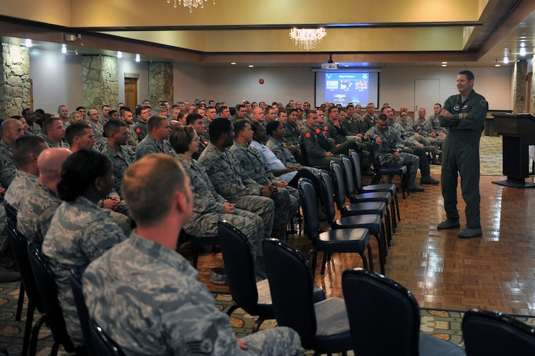 ALTUS AIR FORCE BASE, Okla. – U.S. Air Force Gen. Robin Rand, commander of Air Education and Training Command, speaks to NCOs about current Air Force topics and his priorities during one of his commander's calls with Airmen of the 97th Air Mobility Wing Aug. 7, 2014. Rand held commander's calls with NCOs, CGOs, commanders, chiefs and first sergeants. (U.S. Air Force photo by Senior Airman Dillon Davis/Released)