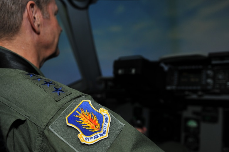 ALTUS AIR FORCE BASE, Okla. – U.S. Air Force Gen. Robin Rand, commander of Air Education and Training Command, wore the 97th Air Mobility Wing patch on his flight suit while visiting the 58th Airlift Squadron C-17 Globemaster III simulators Aug. 7, 2014. In the simulator, Rand was able to simulate in-flight refueling and assault landings to get a feel for what the 97th Air Mobility Wing training mission consists of. (U.S. Air Force photo by Senior Airman Dillon Davis/Released)