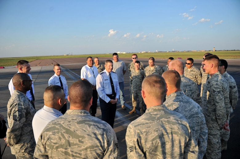 ALTUS AIR FORCE BASE, Okla. – U.S. Air Force Gen. Robin Rand, commander of Air Education and Training Command, speaks to Airmen of the 97th Civil Engineer Squadron during a demonstration of the in-house rubber removal process on the flightline Aug. 7, 2014. Rand spoke to the Airmen about current Air Force topics and encouraged them to keep up the good work. (U.S. Air Force photo by Senior Airman Dillon Davis/Released)