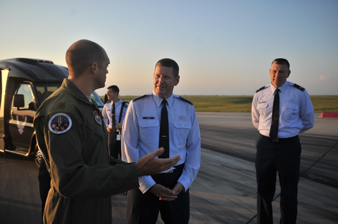 ALTUS AIR FORCE BASE, Okla. – U.S. Air Force Maj. Matt Valero, 97th Operations Group, briefs U.S. Air Force Gen. Robin Rand, commander of Air Education and Training Command, about how the in-house rubber removal process has saved the base money Aug. 7, 2014. The in-house rubber removal process is accomplished by the 97th Civil Engineer Squadron instead of paying an outside contractor to do the same job which allows the base to use the money saved for other mission essential operations. (U.S. Air Force photo by Senior Airman Dillon Davis/Released)