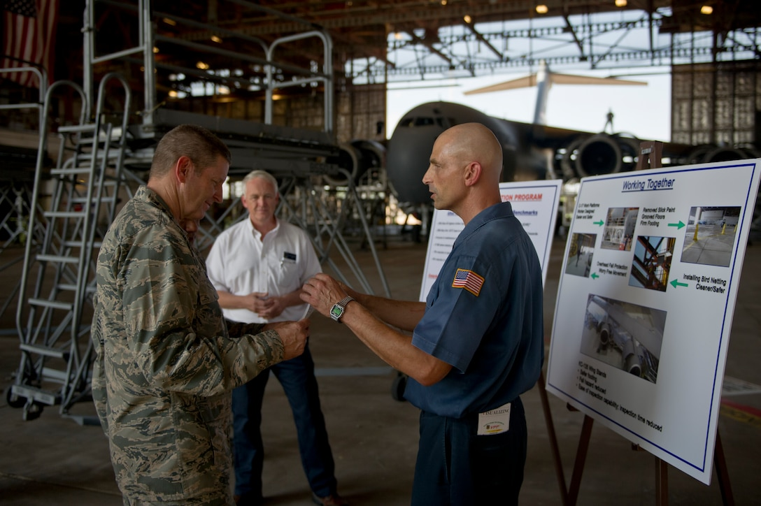 ALTUS AIR FORCE BASE, Okla. – U.S. Air Force Gen. Robin Rand, commander of Air Education and Training Command, speaks to David Dresser, 97th Maintenance Directorate, about Altus' Voluntary Protection Program during a visit to the maintenance hangar Aug. 6, 2014. Dresser explained in detail what the program has done to improve the safety and efficiency of the base's maintainers. (U.S. Air Force photo by Senior Airman Dillon Davis/Released)