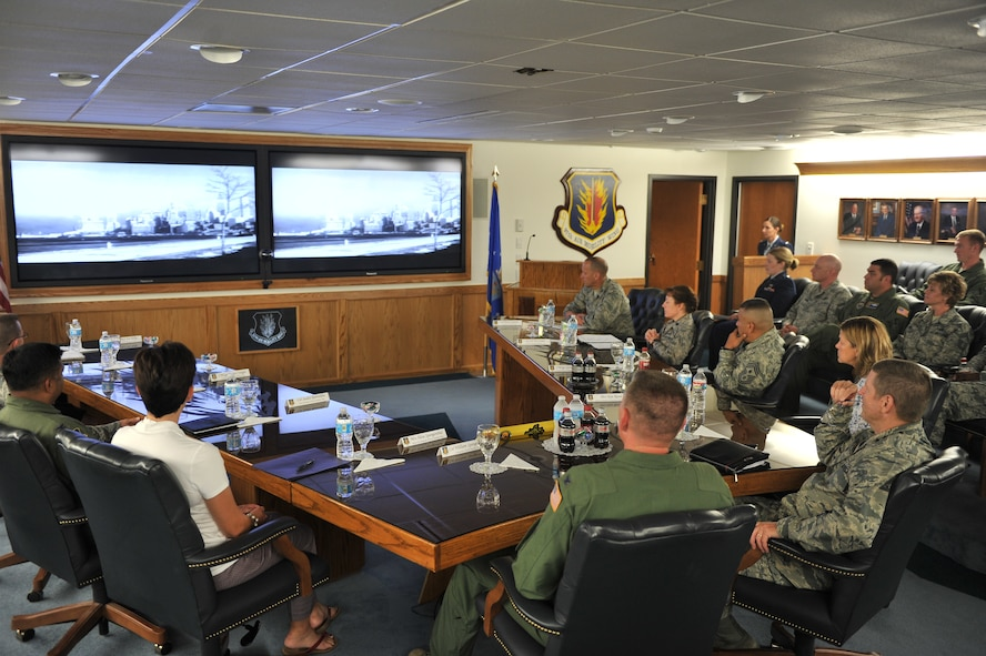 ALTUS AIR FORCE BASE, Okla. – U.S. Air Force Gen. Robin Rand, commander of Air Education and Training Command, his wife Kim, and U.S. Air Force Chief Master Sgt. Gerardo Tapia, AETC command chief, watch the 97th Air Mobility mission video during a briefing inside the Wing Conference Room Aug. 6, 2014. The new mission video introduced Air Force heritage to align with AETC priorities and better inform viewers of the new mission recently assigned to Altus AFB. (U.S. Air Force photo by Senior Airman Dillon Davis/Released)