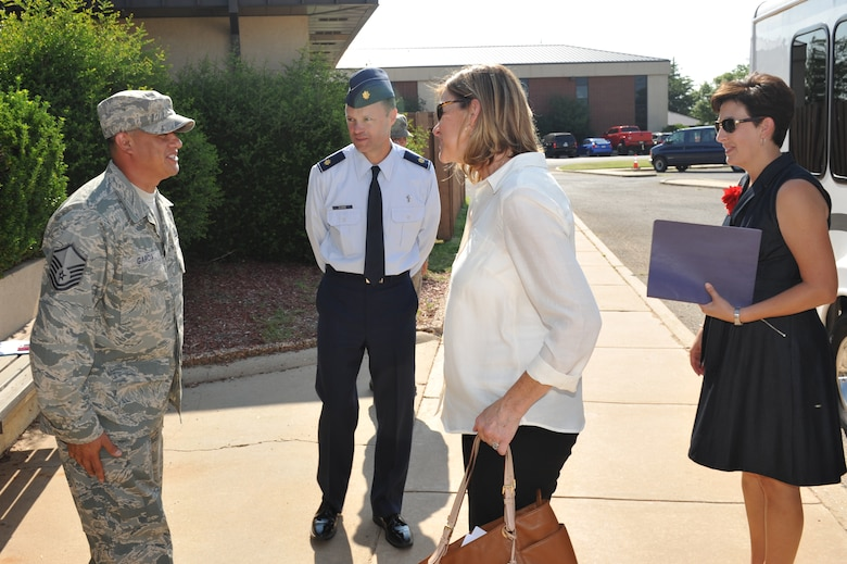 ALTUS AIR FORCE BASE, Okla. – U.S. Air Force Master Sgt. Jason Garcia, 97th Air Mobility Wing Chapel assistant, and U.S. Air Force Maj. Bryan Clouse, 97th Air Mobility Wing chaplain, greet Mrs. Kim Rand, spouse of Gen. Robin Rand, commander of Air Education and Training Command, and Mrs. Alisa Spangenthal, spouse of the 97th AMW commander, at the Airmen Resiliency Center during Rand's tour Aug. 7, 2014. Clouse and Garcia informed Rand of some of the great things that the ARC is doing for Airmen including the Airmen's Pantry and Airmen's Attic. (U.S. Air Force photo by Airman 1st Class J. Zuriel Lee/Released)