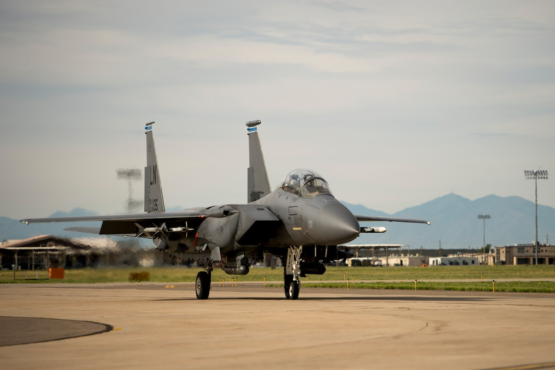An F-15E Strike Eagle assigned to the 494th Fighter Squadron, Royal Air Force Lakenheath, England, prepares for take-off during an air-to-ground Weapons System Evaluation Program (WSEP) at Hill AFB, Utah, Aug. 13, 2014. WSEP is an annual training exercise where the effectiveness, maintainability, suitability and accuracy of guided munitions is evaluated. The 494th FS, as well as the 510th FS from Aviano Air Base, Italy, joined the 388th Fighter Wing of Hill AFB, Utah. (U.S. Air Force photo by Airman 1st Class Taylor Queen/Released)