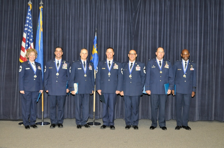 Seven members of the Nevada Air National Guard received the Order of Nevada on August 17th at the Nevada Air National Guard base here in Reno. The Order is awarded for exceptional meritorious service of 25 years to the United States military. Of this service, 20 years must be in the Nevada National Guard. Order recepients (left to right): Chief Master Sgt. Evelyn Anderson, Chief Master Sgt. James Warner, Col. Mitch Sperling, Chief Master Sgt. Michael Drisdale, Chief Master Sgt. Joseph Martini, Col. John Week and Brig. Gen. Ondra Berry. (Photo by Staff Sgt. Melinda Mier, 152nd Airlift Wing Public Affairs. RELEASED.)