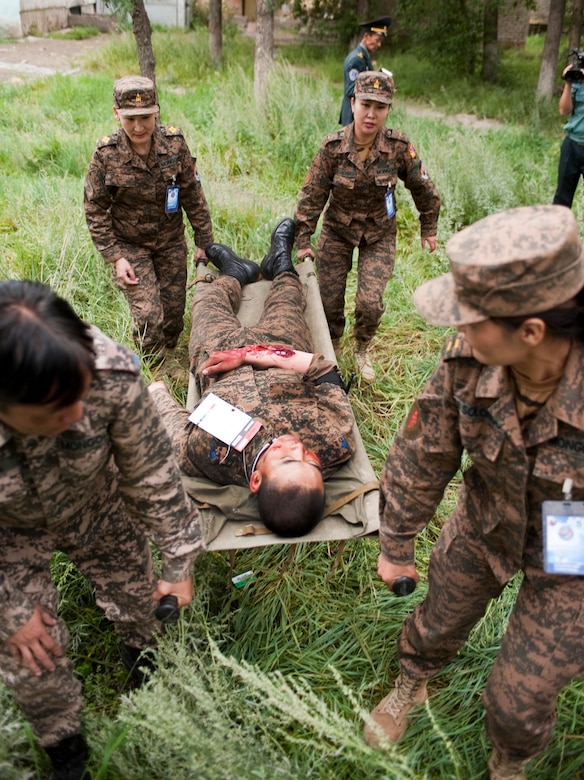 Mongolian armed forces first responders move victims during a during a mass casualty response exercise as part of Operation Pacific Angel 14-4 Mongolia, Aug. 8 2014, Ulaanbaatar, Mongolia. Operation PACANGEL helped cultivate common bonds and fosters goodwill between the U.S., Mongolia and regional nations by conducting multilateral humanitarian assistance and civil military operations. (U.S. Air Force photo/Staff Sgt. William Banton)
