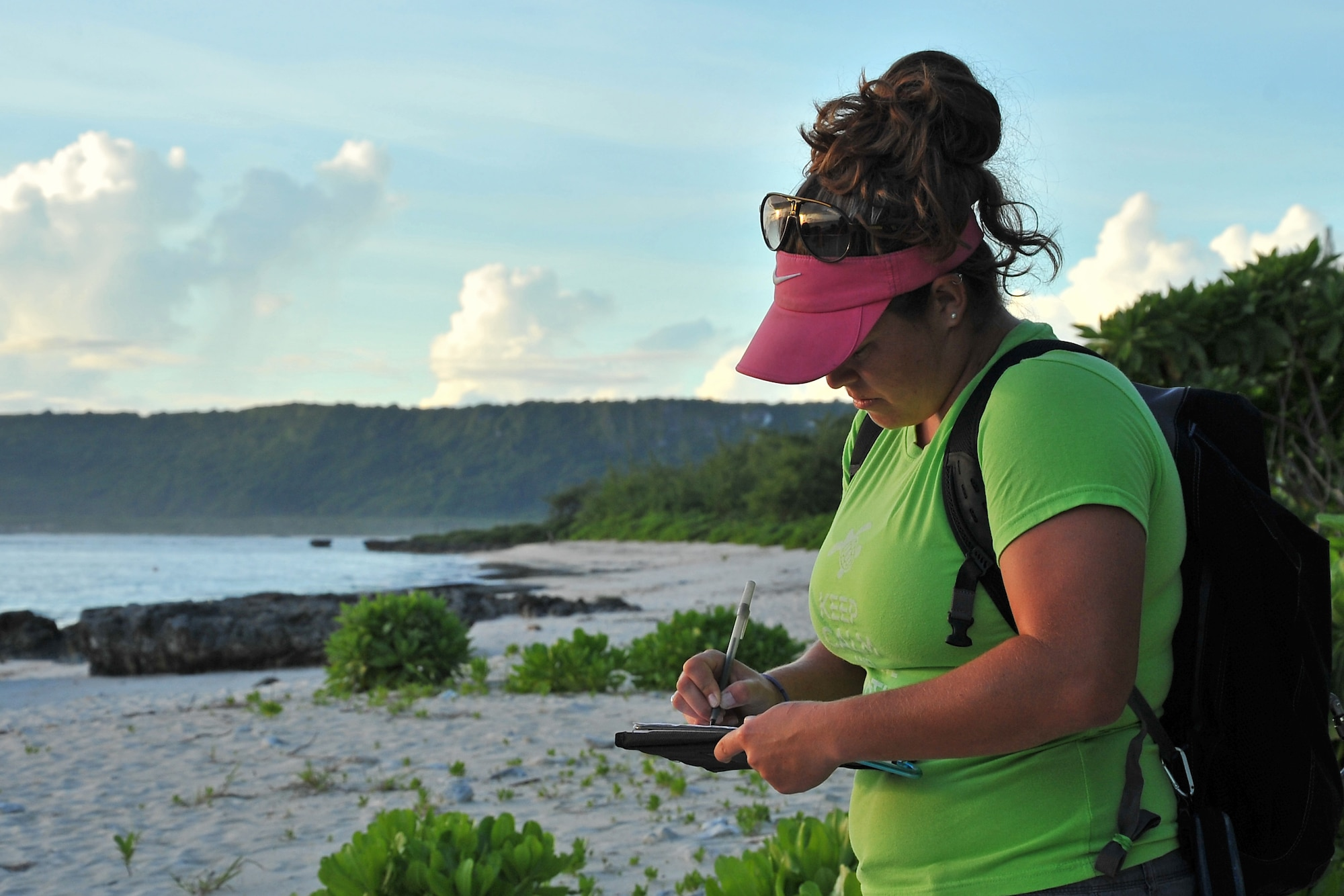 Marylou Staman begins a survey of beaches in the Tarague Basin Aug. 13, 2014, on Andersen Air Force Base, Guam. Staman and a scientific research team have monitored 14 nests in the basin since they started the surveys in March 2014 and have recorded a total of 984 hatchlings thus far. Staman is a University of Guam Sea Turtle Monitoring, Protection and Educational Outreach on Guam project manager. (U.S. Air Force photo/Staff Sgt. Melissa B. White)