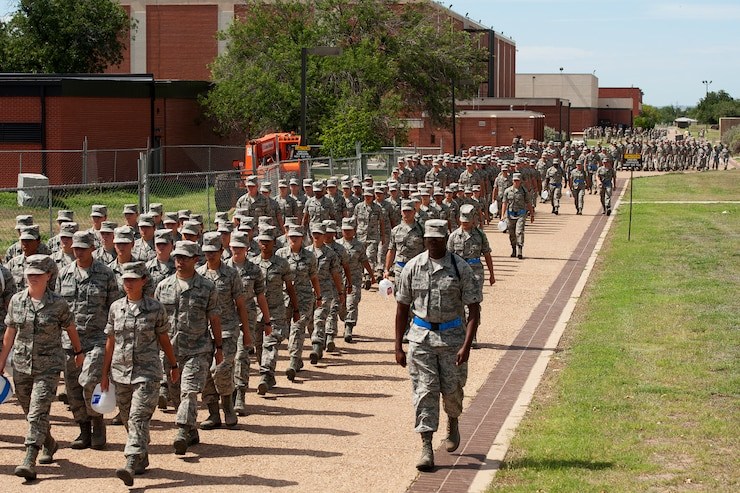 GOODFELLOW AIR FORCE BASE, Texas – The 315th Training Squadron marches down the troop walk at the end of the academic day July 7. The 315th TRS has over 220 instructors training more than 4,800 students annually for global intelligence, surveillance and reconnaissance missions. (U.S. Air Force photo/ Airman 1st Class Devin Boyer)