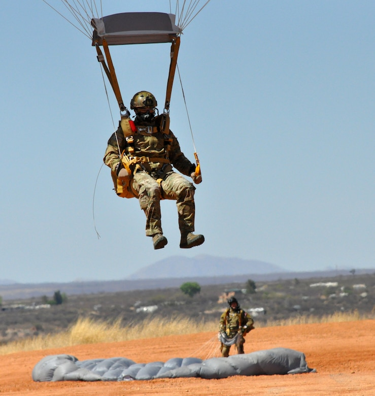 "A pararescueman from the 306th Rescue Squadron lands at a drop zone during a HALO (High Altitude Low Opening) jump training exercises. The 306th Rescue Squadron is an Air Force Reserve unit assigned to the 943rd Rescue Group at Davis-Monthan Air Force Base, Ariz. The 306th RQS is a pararescue squadron that trains to maintain the capability to perform day or night rescue missions in any adverse weather conditions and their motto is ""That Others May Live."" (U.S. Air Force Photo/ Staff Sgt. Sarah Pullen)"