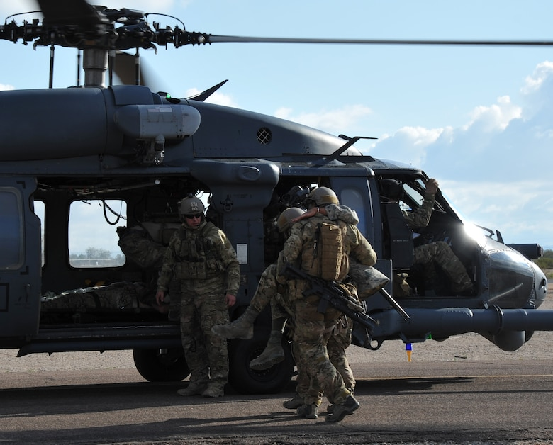 Pararescuemen from the 306th Rescue Squadron load patients on a HH-60G Pave Hawk from the 305th Rescue Squadron helicopter during a pre-deployment training exercise in December 2011. Both the 305th and 306th Rescue Squadrons are part of the 943rd Rescue Group, which is the only rescue group in the entire Air Force Reserve. It's mission is to train personnel, with equipment, to achieve and maintain the capability to perform day or night combat rescue missions; search for, locate and recover U.S. Air Force and other Department of Defense personnel involved with U.S. defense activities; provide search and rescue support of civilians as directed by the Air Force Rescue Coordination Center; and provide humanitarian and disaster relief operations. (U.S. Air Force Photo/ Master Sgt. Luke Johnson)