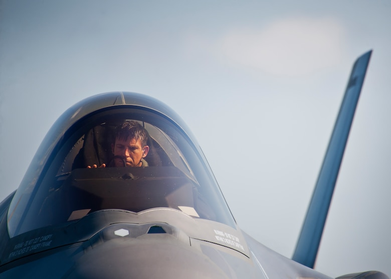 Capt. Elijah Supper, an F-35A Lightning II pilot with the 58th Fighter Squadron, powers down his aircraft after landing at Duke Field Aug. 6.  The joint strike fighter landed at Duke for the first time moments later to participate in a joint base exercise.  (U.S. Air Force photo/Tech. Sgt. Sam King)