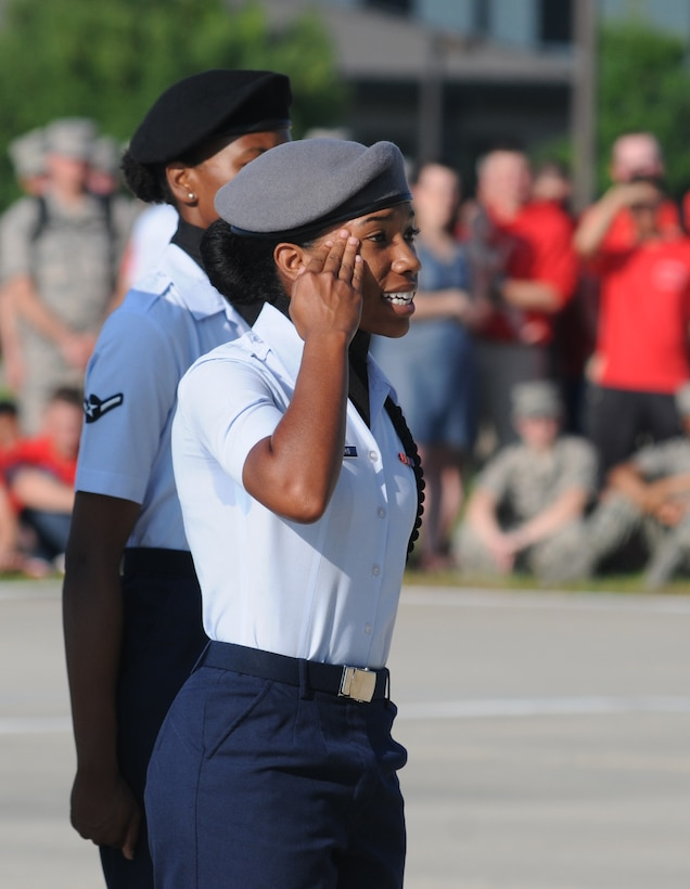 "Airman Basic Ballad Burroughs, 335th Training Squadron regulation drill master, requests permission to enter the field of regulation drill competition during the 81st Training Group's drill down competition Aug. 15, 2014, behind the Levitow Training Support Facility at Keesler Air Force Base, Miss.  The 335th TRS ""Bulls"" placed second in regulation and third overall.  (U.S. Air Force photo by Kemberly Groue)"