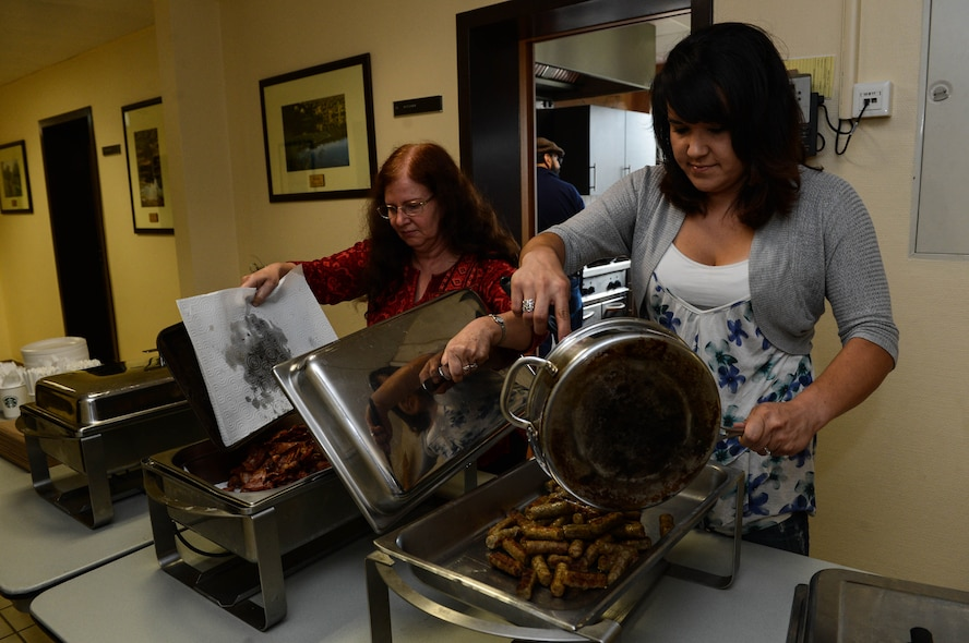 Charlotte Riter, a Geraldine, Mont., native, right, and Judy Castillo, a Phoenix native, left, serve breakfast in the chapel at Spangdahlem Air Base, Germany, Aug. 17, 2014. The Spangdahlem Catholic community hosted the breakfast for families after a religious service. The complimentary meal fed more than 80 people. The chapel provides services for a variety of religious backgrounds. (U.S. Air Force photo by Airman 1st Class Kyle Gese/Released)