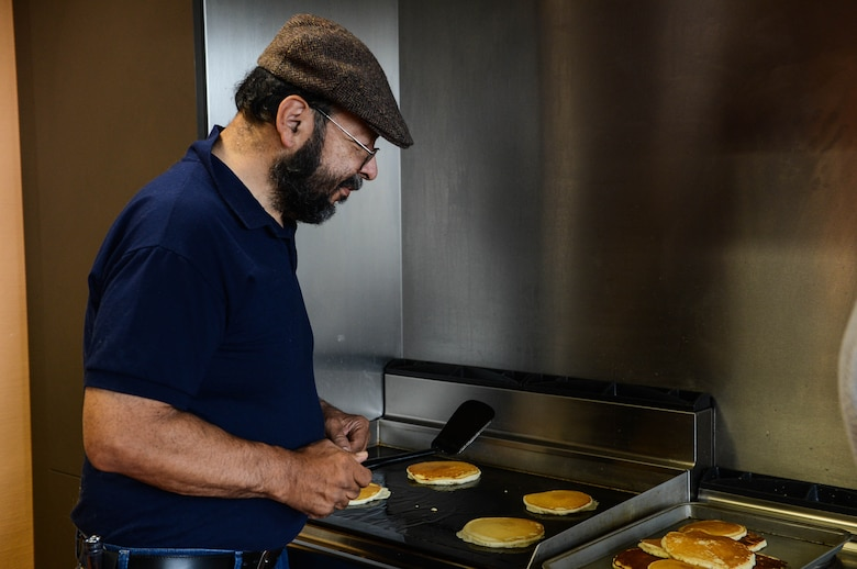 David Castillo, a chapel volunteer from Fresno, Calif., cooks for a pancake breakfast in the chapel at Spangdahlem Air Base, Germany, Aug. 17, 2014. The Spangdahlem Catholic community hosted a breakfast for families after the religious service. The complimentary meal fed more than 80 people. The chapel provides services for a variety of religious backgrounds. (U.S. Air Force photo by Airman 1st Class Kyle Gese/Released)