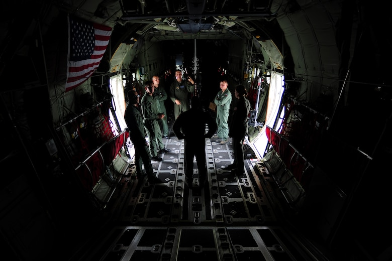 U.S. and Polish Air Force loadmasters discuss mass container delivery airdrop operations aboard a C-130J Super Hercules at Powidz Air Base, Poland, Aug. 11, 2014. Airmen from both nations discussed operational similarities and best practices in preparation for Poland to conduct an equipment and supply mission to Iraq. (U.S. Air Force photo by Staff Sgt. Jarad A. Denton/Released)