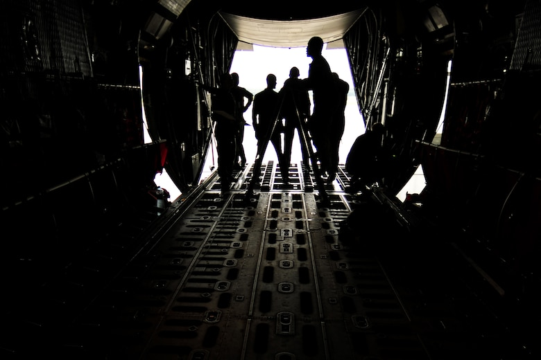 U.S. Air Force Master Sgt. Chris Minnifield, 37th Airlift Squadron loadmaster, climbs a ladder to demonstrate proper cargo and airdrop loading operations on a Polish Air Force C-130E Hercules at Powidz Air Base, Poland, Aug. 11, 2014. Loadmasters from The U.S. and Polish Air Force came together to share operational procedures and improve best practices. (U.S. Air Force photo by Staff Sgt. Jarad A. Denton/Released)