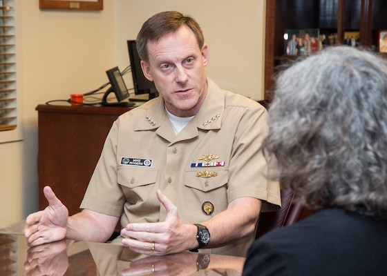 Navy Adm. Mike Rogers, commander of U.S. Cyber Command and director of the National Security Agency, speaks with a DoD News reporter during an interview at the NSA headquarters building at Fort Meade, Md., Aug. 14, 2014. DoD photo