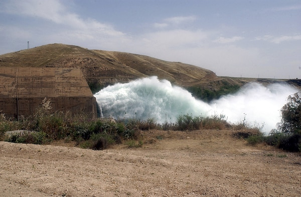 Water pours from a waterway at the Mosul hydro-electric dam May 14, 2003.  U.S. Army photo by Staff Sgt. Brendan Stephens