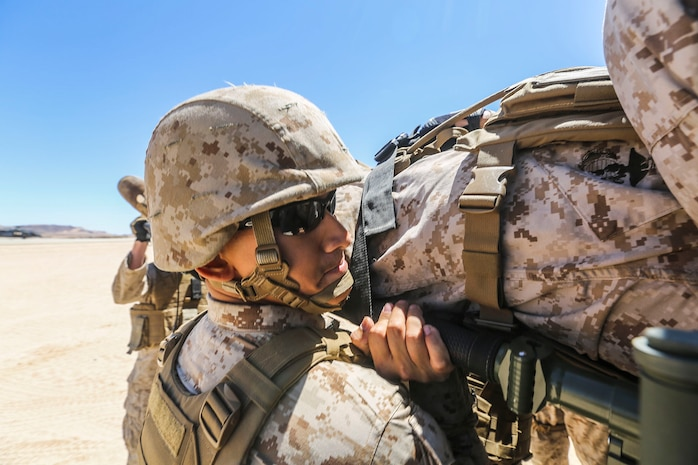 A corpsman with 1st Medical Battalion, 1st Marine Expeditionary Brigade, transports a simulated wounded Marine as part of a mock casualty evacuation at Marine Corps Air Ground Combat Center Twentynine Palms, Calif., Aug. 6, 2014. The casualty evacuation was part of Large Scale Exercise 2014, being conducted from Aug. 8-14. LSE-14 is a bilateral training exercise between the U.S. and Canada which includes live, simulated, and constructive operations to enhance both countries' ability to activate and deploy a Marine Air Ground Task Force with speed and effectiveness in support of the full range of military operations as required by combatant commanders. (U.S. Marine Corps photo by Lance Cpl. Caitlin Bevel)