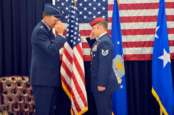 Tech. Sgt. Matthew McKenna salutes Lt. Gen. Bradley Heithold Aug. 18, 2014, after being awarded the Silver Star during the 22nd Special Tactics Squadron awards ceremony at Joint Base Lewis-McChord, Wash. McKenna was the fourth 22nd STS member to earn the medal for operations conducted in Iraq and Afghanistan McKenna is a 22nd STS combat controller and Heithold is the the Air Force Special Operations Command commander. (U.S. Air Force photo/Staff Sgt. Russ Jackson)
