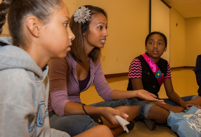 Jackie Dolliole, center, program assistant with the Youth and Teen Center, guides girls in a game during a Smart-Girl retreat in the Miramar Room at the Hub aboard Marine Corps Air Station Miramar, Calif., Aug. 16. The Smart-Girl program provides girls research-based information about topics and subjects other girls their age would likely be learning through rumors and hearsay from unreliable sources.