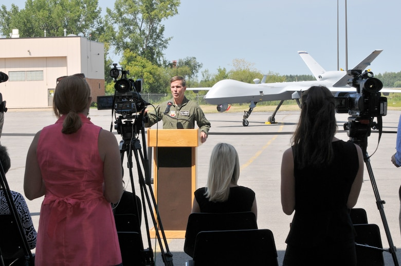 New York Air National Guard Col. Greg Semmel, commander of the 174th Attack Wing (ATKW) speaks to the media at Hancock Field Air National Guard Base in Syracuse NY on 19 August 2014.  Semmel was speaking about the future of MQ-9 operations at Hancock Field.  During the event the media was able to witness the first Taxi of an MQ-9 at Hancock Field.  (New York Air National Guard photo by Tech. Sgt. Jeremy M. Call)