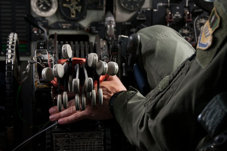 "U.S. Air Force Maj. Jason Dymond, instructor pilot, 11th Bomb Squadron, simulates how a co-pilot ensures a pilot has pushed throttles to ""thrust gate"" at initial take off during a static tour of a B-52 Stratofortress at Barksdale Air Force Base, La., Aug. 18, 2014. Dymond was one of the briefers for a group of visitors from the Nuclear Command and Control Support Staff. (U.S. Air Force photo by Master Sgt. Jeff Walston/Released)"
