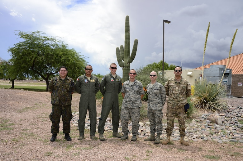 Lt. Col. Trae York (third from the right), Director of Spaces Forces, 12th Air Force (Air Forces Southern), stands for a photo with U.S. Air Force active duty, guard and partner nation representatives from the PANAMAX 2014 space team at Davis-Monthan AFB, Ariz., Aug. 14, 2014. This was the third year that partner nation participants took part in the space element of the exercise. (U.S. Air Force photo by Tech. Sgt. Heather R. Redman/Released)
