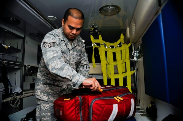 Staff Sgt. John Reyes, 51st Aerospace Medicine Squadron medical standards management element NCO in charge, performs a daily equipment check on a medical jump bag on Osan Air Base, Republic of Korea, Aug. 13, 2014. Reyes is this week's Airman Spotlight winner. (U.S. Air Force photo/Senior Airman David Owsianka)
