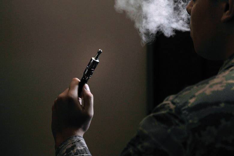 An Airman holds an electronic cigarette at Scott Air Force Base, Illinois, Aug. 13, 2014. The Centers for Disease Control and Prevention is investigating the more than 2,000 cases of e-cigarette, or vaping, product use associated lung injury that have occurred across the country. (U.S. Air Force photo by Airman 1st Class Erica Crossen)