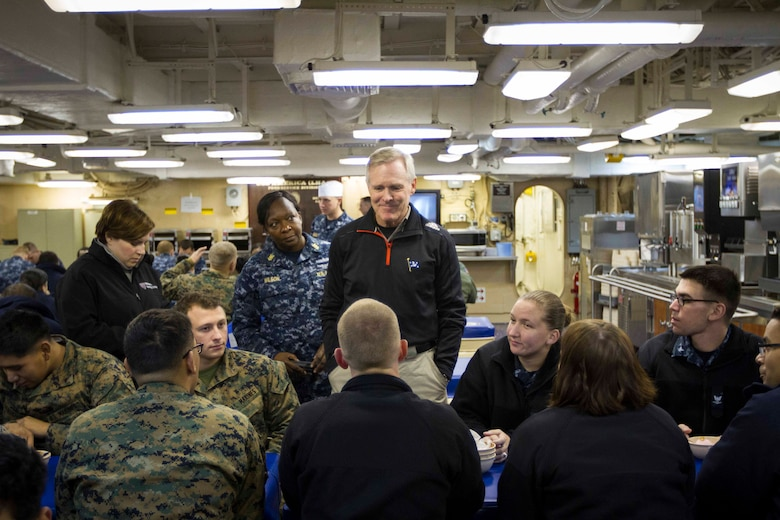 "Secretary of the Navy Ray Mabus speaks with Marines and Sailors with the future amphibious assault ship USS America (LHA 6) and Special Purpose Marine Air Ground Task Force South during an ice cream social held in the hero's cafe aboard the ship, Aug. 19, 2014. Mabus sat with the Marines and Sailors to allow for topics of interest to be discussed on a personal level. In addition to the ice cream social, Mabus toured the ship and held an all-hands meeting to address the Marines and Sailors. Visits like this remind the Marines and Sailors with America and the SPMAGTF of the significance of the work they are doing. SPMAGTF-South is embarked aboard America in support of her maiden transit, ""America Visits the Americas."" Through partner-nation activities, theater security events and key leader engagements, the transit aims to demonstrate the flexibility, utility and unparalleled expeditionary capability the Navy-Marine Corps team provides our nation and partners. (U.S. Marine Corps Photo by Cpl. Donald Holbert/ Released)"