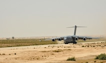 An Air Force C17 Globemaster III lands on an old airstrip  Aug. 19, 2014, in the Sinai Peninsula of Egypt. the airstrip is now used by the Multinational Force and Observers stationed in Sinai, Egypt. The Airmen landed in the Sinai to help provide airlift support of a UH-60 Black Hawk to Soldiers from the Aviation Company, 1st Support Battalion, Task force Sinai. The Blackhawk was loaded into the belly of the C-17 Globemaster and transported to Germany where it will undergo advanced maintenance. The C-17 is from the 62nd Airlift Wing, based out of Joint Base Lewis-McChord, Wash. (U.S. Army Photo/Sgt. Thomas Duval)