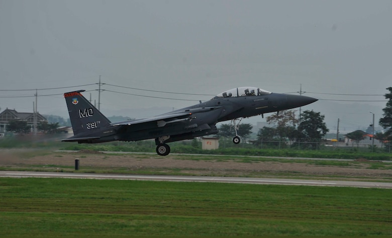 An F-15 Strike Eagle takes off to complete a sortie Aug. 15, 2014 on Osan Air Base, South Korea. The 391st Fighter Squadron sent 12 F-15s to Osan AB for a temporary duty assignment as part of a theater support package. (U.S. Air Force photo/Senior Airman David Owsianka)