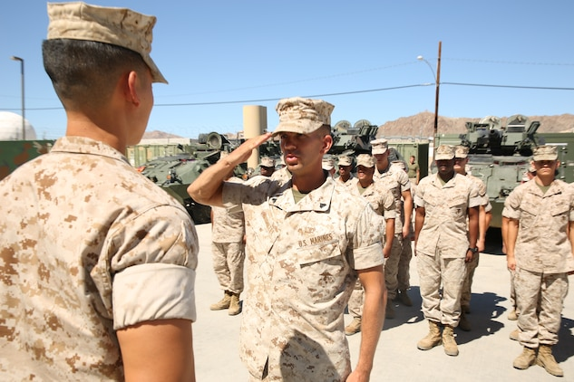 Cpl. Arthur E. Krenzel III, field radio operator, 3rd Light Armored Reconnaissance Battalion, salutes Capt. Kelvin Chew, communications officer, S-6, 3rd Light Armored Reconnaissance Battalion, during his meritorious promotion ceremony at the Communications Building of 3rd LAR, Aug. 15, 2014.