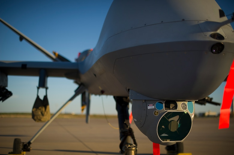 An MQ-9 Reaper sits on the flight line of Holloman Air Force Base, N.M., Aug. 19, prior to maintenance that will keep it flying and training the next generation of Air Force pilots and sensor operators. The MQ-9 Reaper is a medium-to-high altitude, long endurance unmanned aircraft system. The MQ-9's primary mission is as a persistent hunter-killer against emerging targets to achieve joint force commander objectives. The MQ-9's alternate mission is to act as an intelligence, surveillance and reconnaissance asset, employing sensors to provide real-time data to commanders and intelligence specialists at all levels.(U.S. Air Force photo by Airman 1st Class Aaron Montoya/Released)