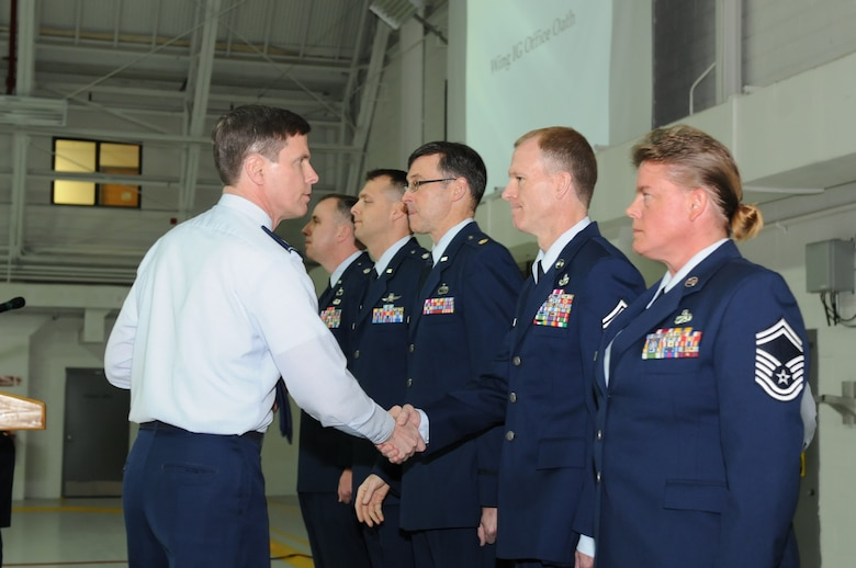 New York Air National Guard Col. Greg Semmel (left), 174th Attack Wing commander, congratulates new wing Inspector General members. The inspector general team will prepare wing members for future basewide inspections. (New York Air National Guard Photo By Tech. Sgt. Justin A. Huett)
