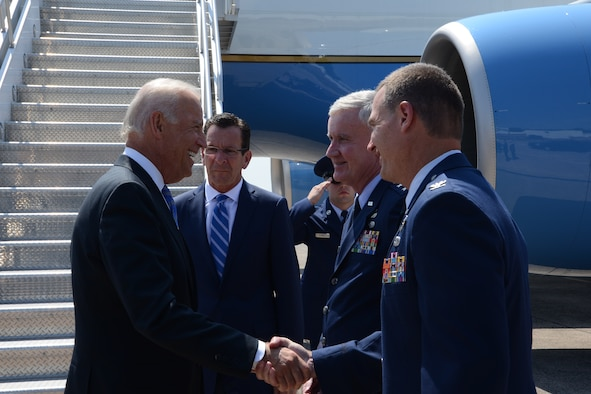 Col. Frank Detorie, commander, 103rd Airlift Wing, Connecticut Air National Guard, shakes hands with Vice President Joseph R. Biden, Jr., alongside Gov. Dannel P. Malloy and Maj. Gen. Thaddeus J. Martin, the Adjutant General and commander of the Connecticut National Guard on August 20, 2014 at Bradley Air National Guard Base, Connecticut. Air Force Two brought the vice president to the air base en route to East Hartford, Connecticut for an event on workforce development.  (U.S. Air National Guard photo by Master Sgt. Erin McNamara/Released)