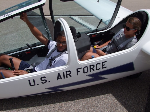 Cadet 3rd Class Kenneth McGhee, upgrader (front seat), and Cadet 2nd Class Miranda Mila instructor pilot (back seat), prepare for a training flight in a TG-16A glider Aug.15. (U.S. Air Force photo/Amber Baillie)