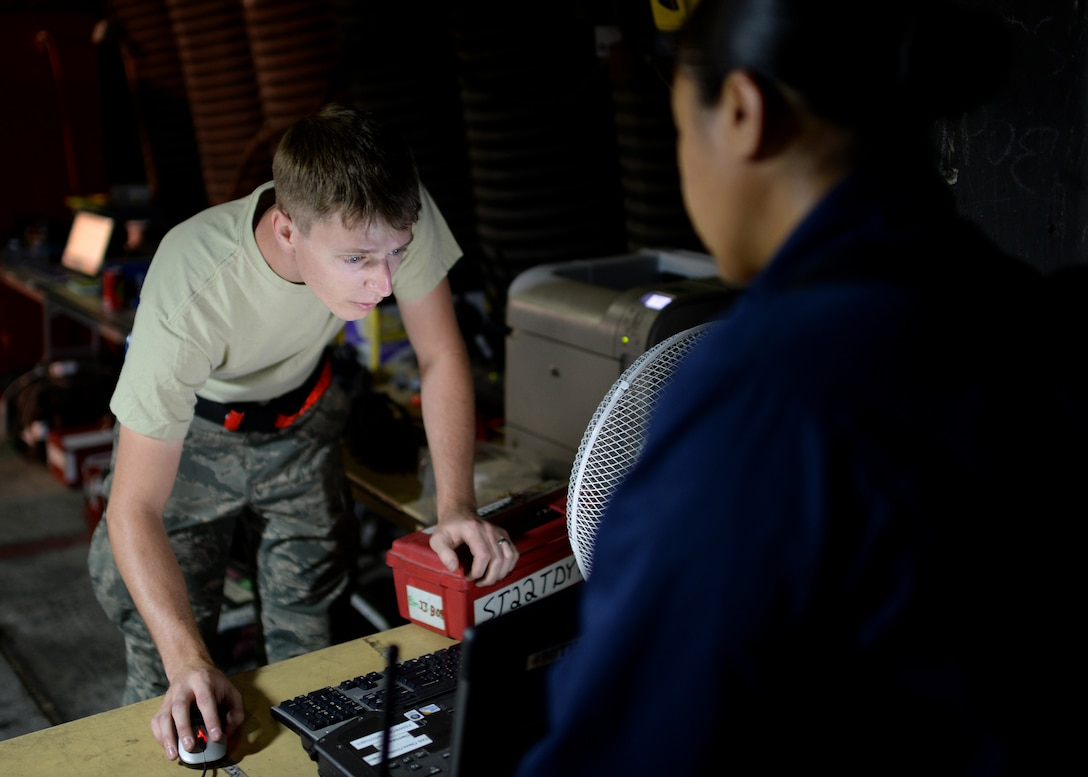U.S. Air Force Senior Airman Coleman Haynes, 52nd Aircraft Maintenance Squadron support technician and native of Nevis, Minn., checks out equipment to U.S. Air Force Staff Sgt. Dionne Williams, 52nd AMXS 480th Aircraft Maintenance Unit jet engine technician and native of Honolulu, Hawaii, at the squadron's supply area in Souda Bay, Greece, Aug. 20, 2014. The launch expectation during the bilateral training between the Hellenic and U.S. air forces is 22 sorties a day, which then requires the constant work of maintenance technicians to sustain aircraft readiness to meet the mission needs. (U.S. Air Force photo by Staff Sgt. Daryl Knee/Released)