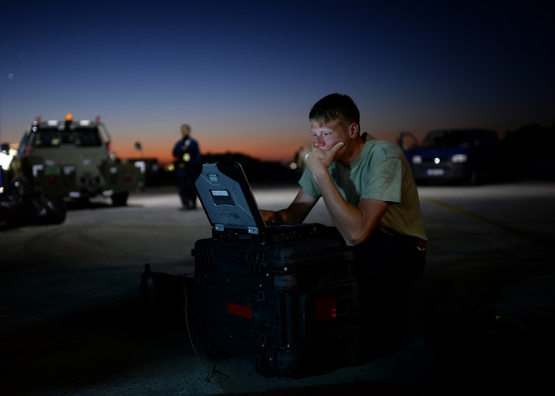 U.S. Air Force Senior Airman Alec Vautherot, 52nd Aircraft Maintenance Squadron 480th Aircraft Maintenance Unit electrical environmental specialist and native of Waterford, Mich., reviews a technical order before beginning preventative maintenance on a U.S. Air Force F-16 Fighting Falcon fighter aircraft at Souda Bay, Greece, Aug. 20, 2014. The equipment Vautherot uses must be checked out each morning from a controlled supply line. (U.S. Air Force photo by Staff Sgt. Daryl Knee/Released)