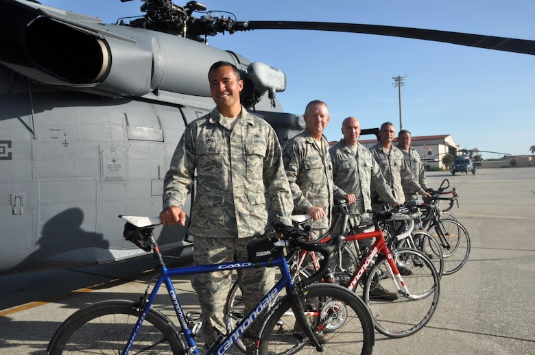 Members from the 920th Maintenance Squadron pose for a picture on the flightline, Patrick Air Force Base, Fla., August 19, 2014. The members are part of a cycling club and plan to participate in the Rocketman Florida Triathlon, October 12, 1014. (U.S. Air Force photo/ Tech. Sgt. Katie Spencer)