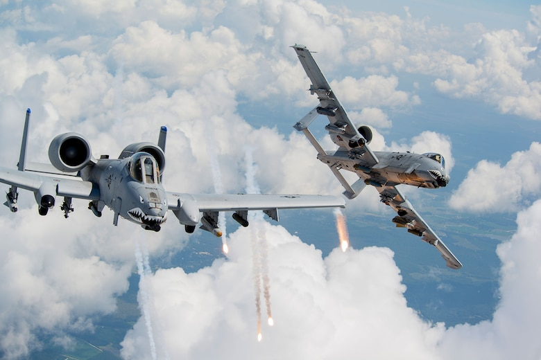Capts. Andrew Glowa, left, and William Piepenbring launch flares from two A-10C Thunderbolt IIs Aug. 18, 2014, over southern Georgia. Both pilots are with the 74th Fighter Squadron, Moody Air Force Base, Ga. Pilots, maintainers and support Airmen ensure Moody AFB's A-10s stay mission ready for daily training sorties and deployments downrange. (U.S. Air Force photo/Staff Sgt. Jamal D. Sutter)