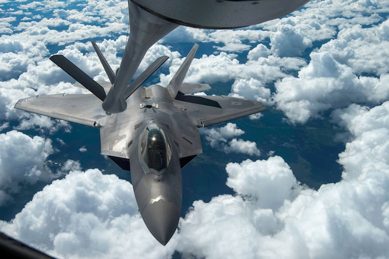 An F-22 Raptor performs a refueling  with a KC-135 Stratotanker during a training mission Aug. 7, 2014, near Joint Base Elmendorf-Richardson, Alaska. The F-22 is designed to project air dominance, rapidly and at great distances. The F-22 is assigned to the 525th Fighter Squadron and the KC-135 is from McConnell Air Force Base, Kan. (U.S. Air Force photo/Staff Sgt. Stephany Richards)