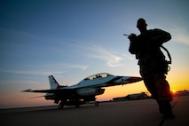 "Staff Sgt. Luis Rodriguez from the New Jersey Air National Guard's 177th Security Forces Squadron conducts an early morning walk-around of a Thunderbirds  F-16D Fighting Falcon Aug. 11, 2014, at Atlantic City Air National Guard Base, N.J. The Thunderbirds are the premier flying demonstration group and performed for the Atlantic City ""Thunder Over the Boardwalk Airshow"" Aug. 13.  (U.S. Air National Guard photo/Tech. Sgt. Matt Hecht)"